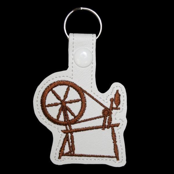 spinning wheel key ring - brown
