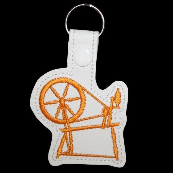 spinning wheel key ring - golden yellow