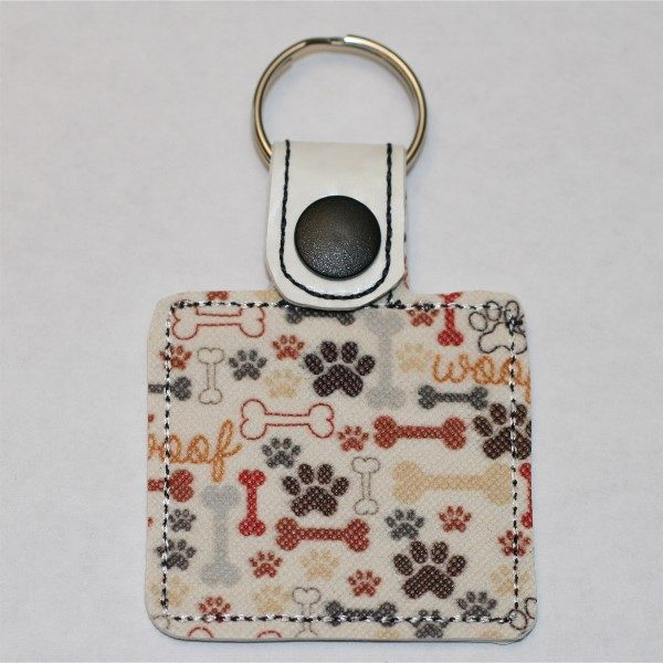 love paw key ring - reverse side with woof print