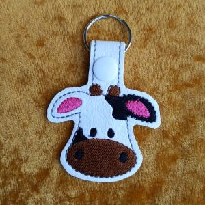 spotted cow face key ring