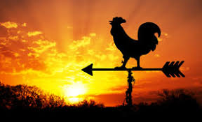sunrise photo with rooster on weather vane