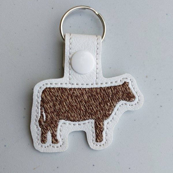 heather brown cow key ring