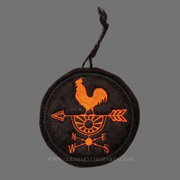rise and shine rooster ornament stitched in orange on black alpaca fiber felt