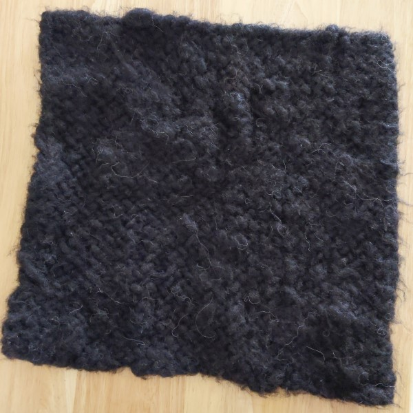 black handwoven alpaca fiber cat mat